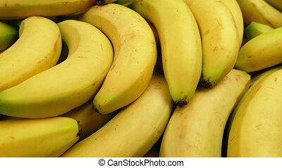 Passing Ripe Yellow Bananas - Tracking shot moving slowly...