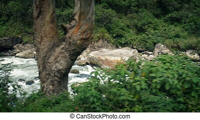 Passing Rocky Jungle River - Moving past a wild jungle river