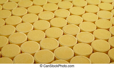 Passing Rows Of Vitamin C Tablets - Passing rows of vitamin...
