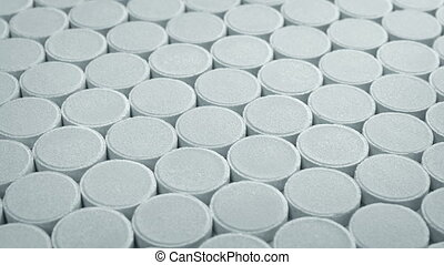 Passing Rows Of White Tablets - Lots of medical tablets...