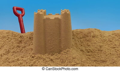 Passing Sand Castle On Beach - Holiday scene of sandcastle...
