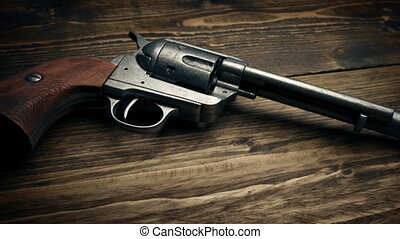 Passing Six Shooter Gun On Table - Passing wild west hand...