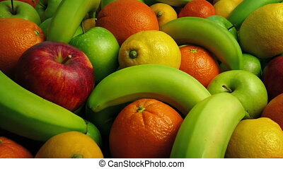 Passing Tasty Fruit Mixture - Apples, oranges lemons buffet...