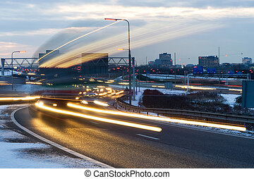 Passing truck - Cars passing by on a motorway junction on a...