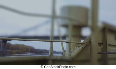 Passing under the bridge on boat's deck - a bottom view