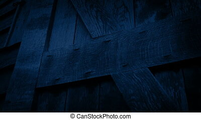 Passing Wooden Barn Door At Night - Moving slowly past an...