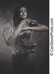 passion, brunette woman posing with a python snake Australian
