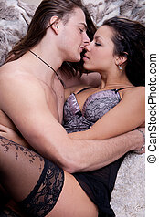 Passion couple - young man with long hair and a muscular...