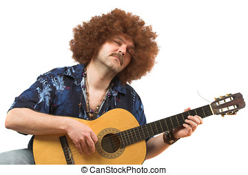 Passion for music - Hippy with old guitar totally into his...