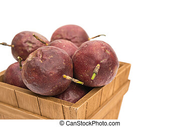 passion fruit in a wooden case on white background