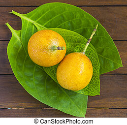 Passion Fruits on Wooden Background - Passion fruits and...