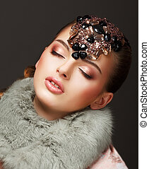 Passion. Glamorous Dreamy Woman in Fur Mantle and Jewels....