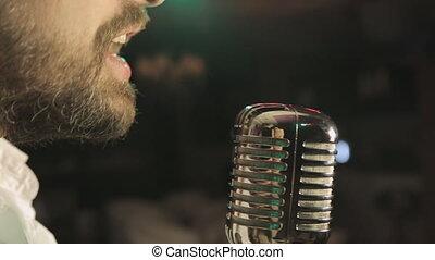 Passion singing in retro microphone in karaoke