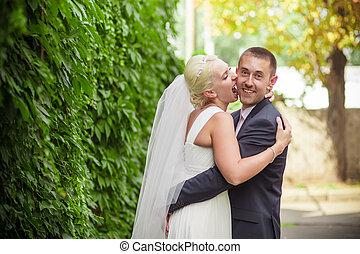 passion wedding groom kiss bride