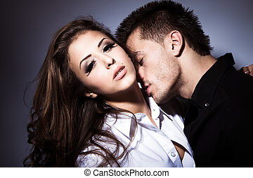 passion - young couple in love kissing, studio shot