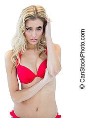 Passionate blonde model looking at camera