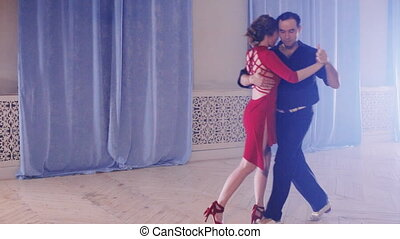 passionate couple dancing tango - passionate couple dancing...