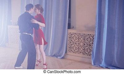 passionate couple dancing tango - passionate couple dancing...