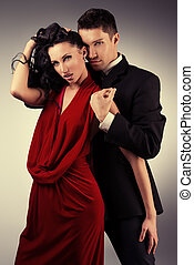 passionate dance - Portrait of a beautiful young couple in...