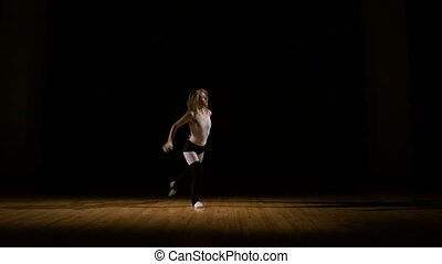 Passionate girl dancer warming up for dance show