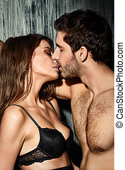 passionate kiss - Beautiful passionate couple of young...