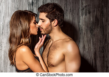 passionate kiss - Beautiful sexy young people in love.