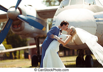 Passionate kiss of the two in their wedding day