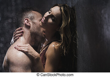 Passionate love affair - Shot of a couple kissing in a ...