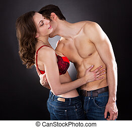 Passionate Man Kissing Woman's Neck