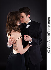 Passionate Man Removing Dress Strap From Woman's Shoulder