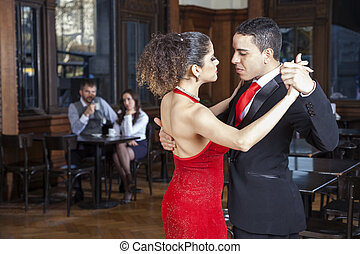 Passionate Tango Dancers Performing While Mid Adult Couple Datin