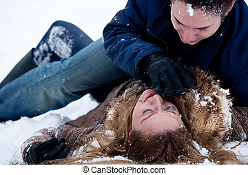 Passionate winter fight - couple being passionate about ...
