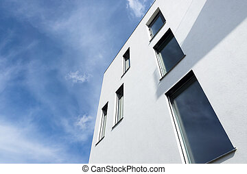 Passive modern building with large windows on a sunny day