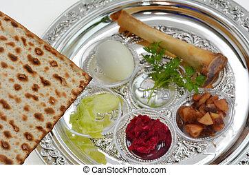 Passover Seder Plate - Matzo bread next to Passover Seder...
