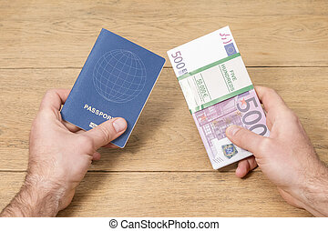 passport and money in male hands