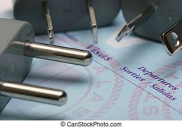 passport and plugs