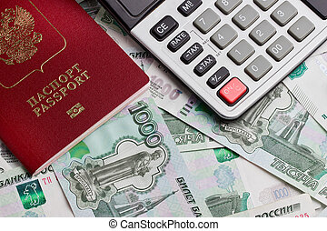 Passport and the calculator on a background of money