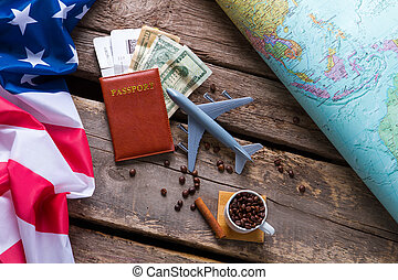 Passport near USA flag. Dollars and coffee beans. Take a...