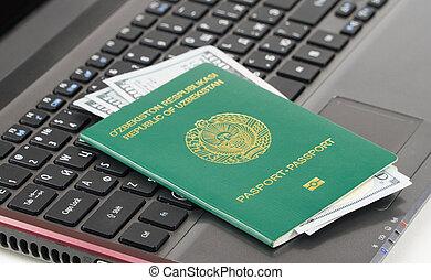Passport of Uzbekistan on the keyboard