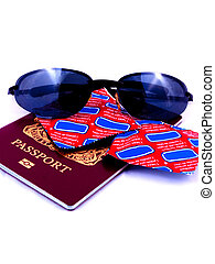 Passport shades and condoms - A passport with sunglasses and...