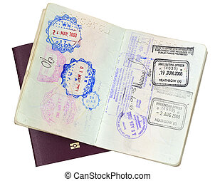 Visa stamps in open passport, over closed EU passport. Clipping path included.