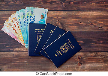 Passport with a note shekel on a wooden table. - Passport ...
