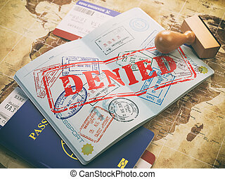 Passport with denied visa stamp on the map of the world and airline boarding pass tickets..Travel concept.