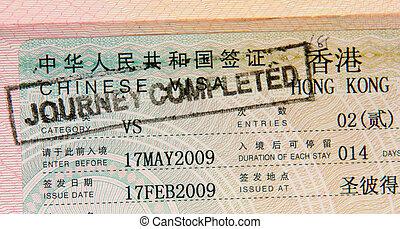 passport with hong kong visa and stamps