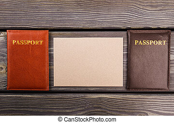 Passports and blank paper for copy space.