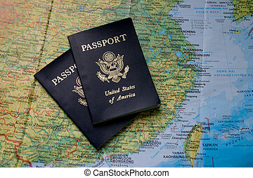 Passports and Map of Asia - Two passports on top of a map of...