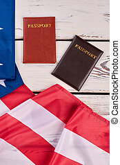 Passports and USA flag, top view.