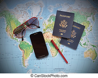 Passports on vacation travel map