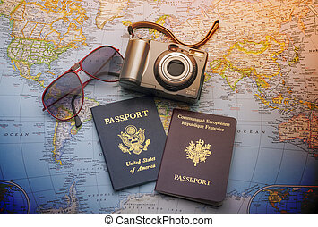 Passports to world travel - Passports, camera and sunglasses...