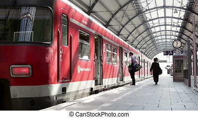 Passsengers on the railroad station - Wiesbaden, Germany -...